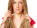 Beautiful girl many plaits hairstyle holding hairs